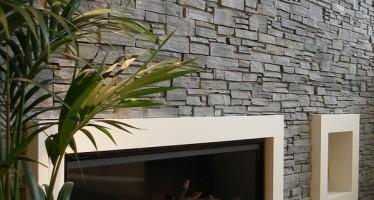 Cheminée et poêle : habiller les murs avec des pierres naturelles